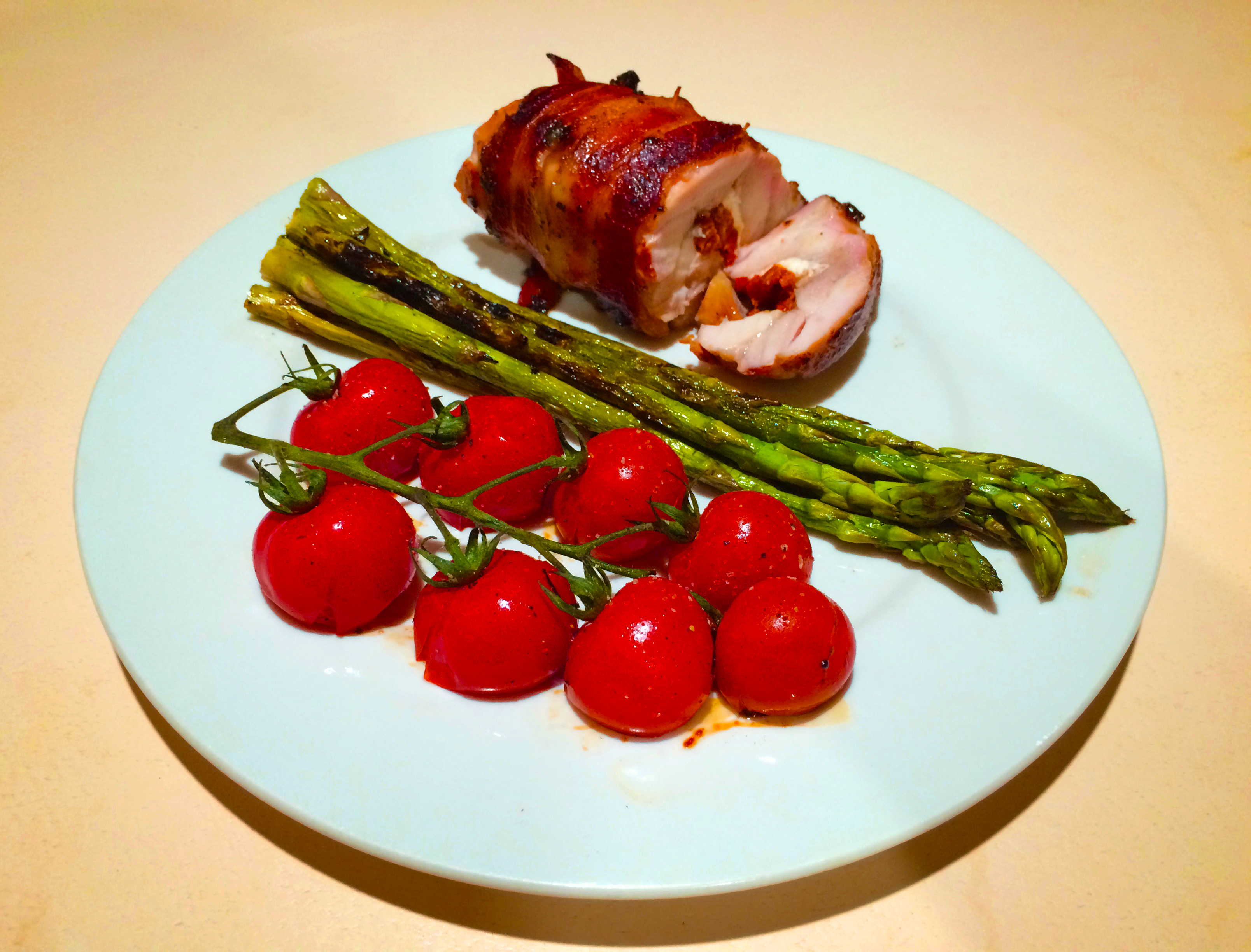 Stuffed Chicken Thighs with Vine-Ripened Cherry Tomatoes and Asparagus